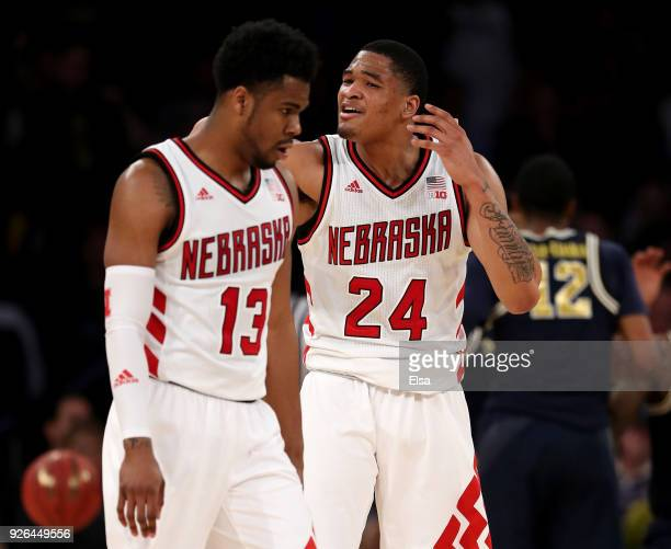 Anton Gill and James Palmer Jr #24 of the Nebraska Cornhuskers react in the second half against the Michigan Wolverines during quarterfinals of the...