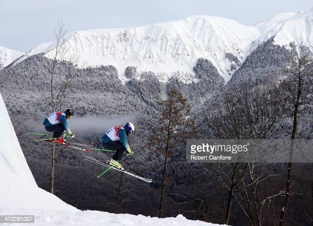 Anton Grimus and Scott Kneller of Australia jump during a Ski Cross training session at Rosa Khutor Extreme Park on day 12 of the Sochi Winter...