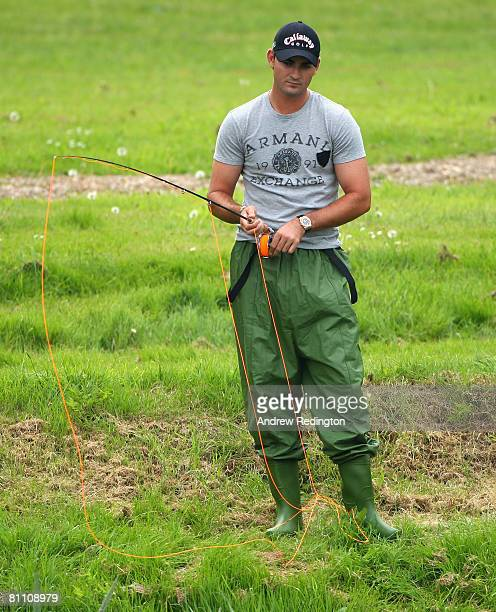 Anton Haig of South Africa trys his hand at fishing after the second round of the Irish Open on May 16 2008 at the Adare Manor Hotel and Golf Resort...