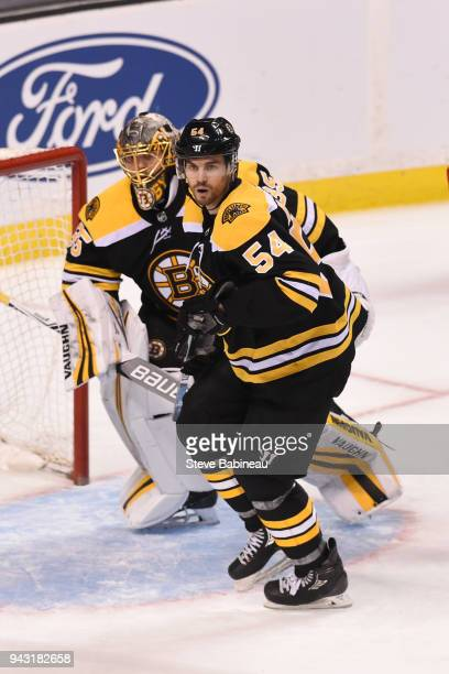 Anton Khudobin and Adam McQuaid of the Boston Bruins against the Ottawa Senators at the TD Garden on April 7 2018 in Boston Massachusetts
