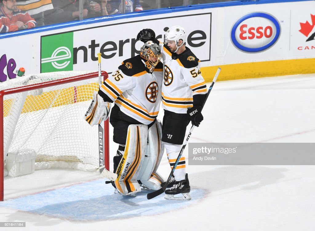 Anton Khudobin #35 and Adam McQuaid #54 of the Boston Bruins celebrate after winning the game against the Edmonton Oilers on February 20, 2018 at Rogers Place in Edmonton, Alberta, Canada.