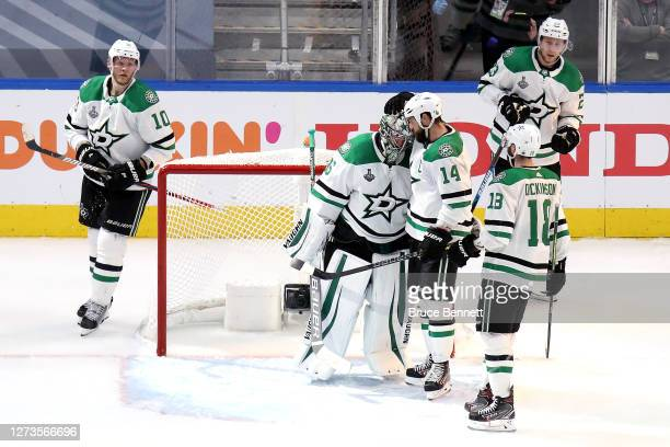 Anton Khudobin and Jamie Benn of the Dallas Stars celebrate their teams 41 victory against the Tampa Bay Lightning in Game One of the 2020 NHL...