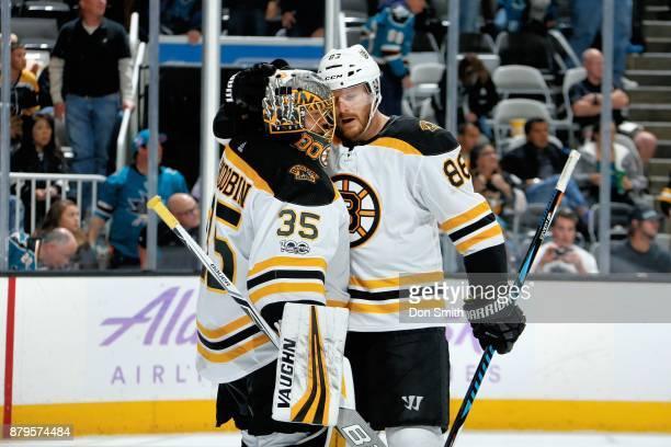 Anton Khudobin and Kevan Miller of the Boston Bruins react to the Bruins win 31 over the San Jose Sharks at SAP Center on November 18 2017 in San...