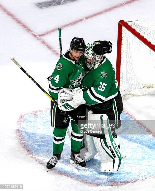 Anton Khudobin and Miro Heiskanen of the Dallas Stars celebrate their teams 2-1 victory against the Vegas Golden Knights in Game Four of the Western...