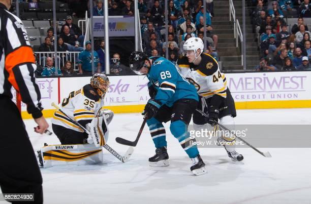 Anton Khudobin and Rob O'Gara of the Boston Bruins defend the net against Mikkel Boedker of the San Jose Sharks at SAP Center on November 18 2017 in...