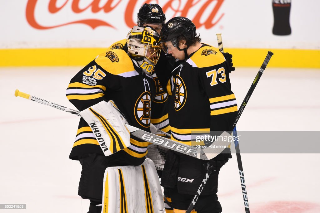Anton Khudobin #35, David Pastrnak #88 and Charlie McAvoy #73 of the Boston Bruins celebrate a win against the Vancouver Canucks at the TD Garden on October 19, 2017 in Boston, Massachusetts.