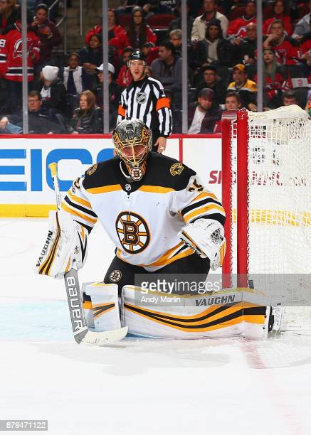 Anton Khudobin of the Boston Bruins defends his net against the New Jersey Devils during the game at Prudential Center on November 22 2017 in Newark...
