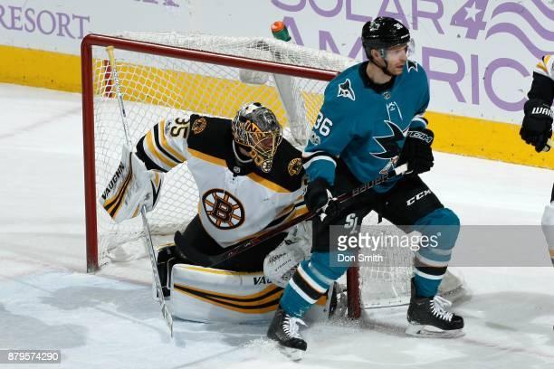 Anton Khudobin of the Boston Bruins defends Jannik Hansen of the San Jose Sharks at SAP Center on November 18 2017 in San Jose California
