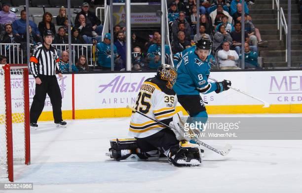 Anton Khudobin of the Boston Bruins defends the net against Joe Pavelski of the San Jose Sharks at SAP Center on November 18 2017 in San Jose...