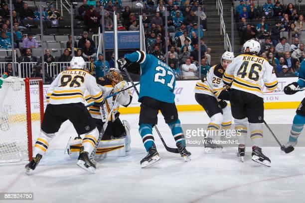 Anton Khudobin of the Boston Bruins defends the net against Joonas Donskoi of the San Jose Sharks at SAP Center on November 18 2017 in San Jose...