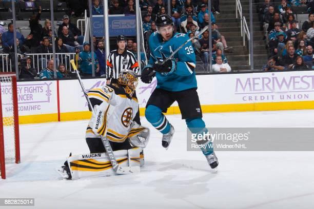 Anton Khudobin of the Boston Bruins defends the net against Logan Couture of the San Jose Sharks at SAP Center on November 18 2017 in San Jose...