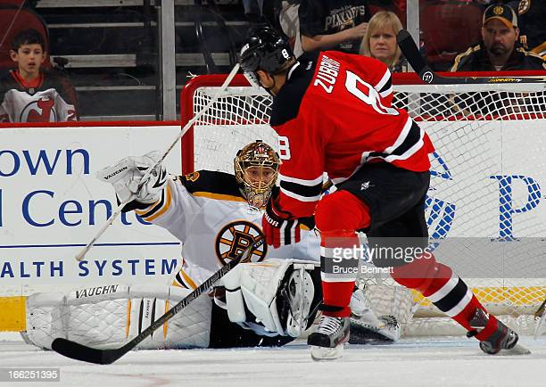 Anton Khudobin of the Boston Bruins gets in position to make the save on Dainius Zubrus of the New Jersey Devils at the Prudential Center on April 10...