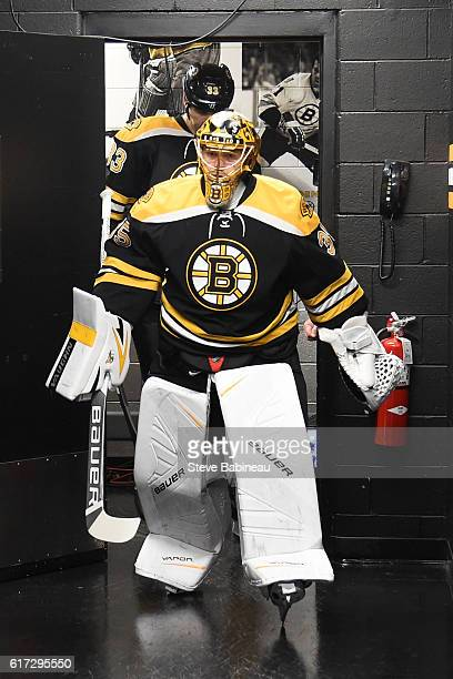 Anton Khudobin of the Boston Bruins leads the time out to the ice for warm ups before the game against the Montreal Canadiens at the TD Garden on...