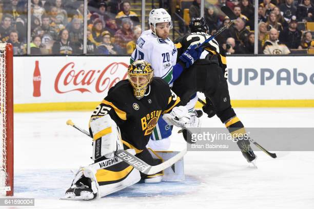 Anton Khudobin of the Boston Bruins looks for the puck against Brandon Sutter of the Vancouver Canucks at the TD Garden on February 11 2017 in Boston...