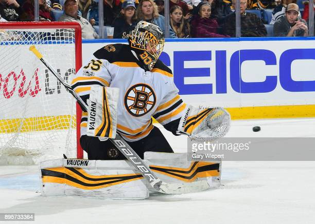 Anton Khudobin of the Boston Bruins makes a save against the Buffalo Sabres during the second period of an NHL game on December 19 2017 at KeyBank...
