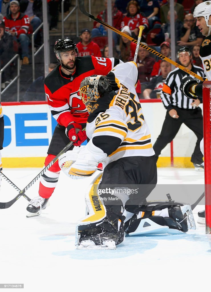 Anton Khudobin #35 of the Boston Bruins makes a save as Drew Stafford #18 of the New Jersey Devils looks for a rebound during the game at Prudential Center on February 11, 2018 in Newark, New Jersey.