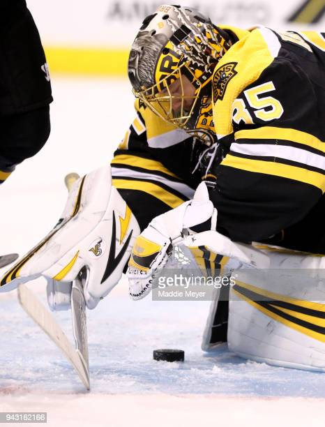 Anton Khudobin of the Boston Bruins makes a save during the second period against the Ottawa Senators at TD Garden on April 7 2018 in Boston...