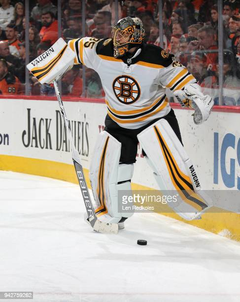 Anton Khudobin of the Boston Bruins plays the puck behind the net against the Philadelphia Flyers on April 1 2018 at the Wells Fargo Center in...