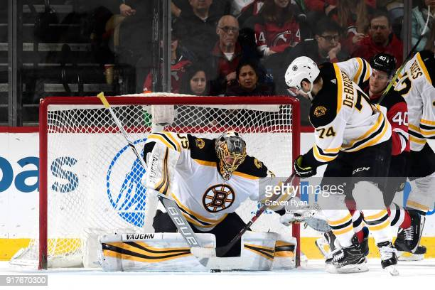 Anton Khudobin of the Boston Bruins stops a shot against the New Jersey Devils at Prudential Center on February 11 2018 in Newark New Jersey The...