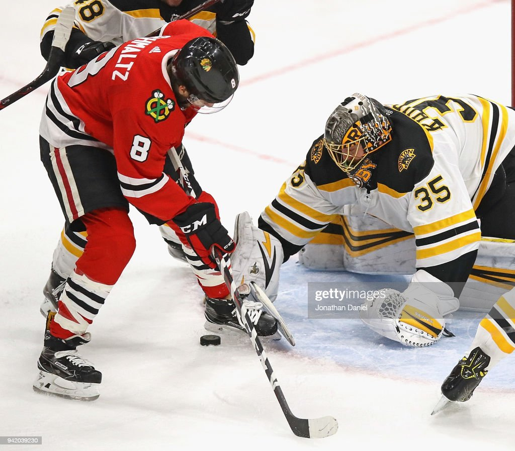 Anton Khudobin #35 of the Boston Bruins stops a shot by Nick Schmaltz #8 of the Chicago Blackhawks at the United Center on March 11, 2018 in Chicago, Illinois. The Blackhawks defeated the Bruins 3-1.