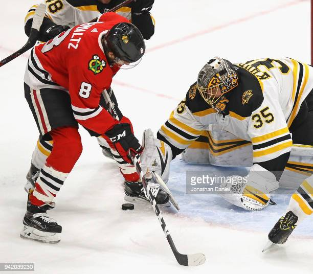 Anton Khudobin of the Boston Bruins stops a shot by Nick Schmaltz of the Chicago Blackhawks at the United Center on March 11 2018 in Chicago Illinois...