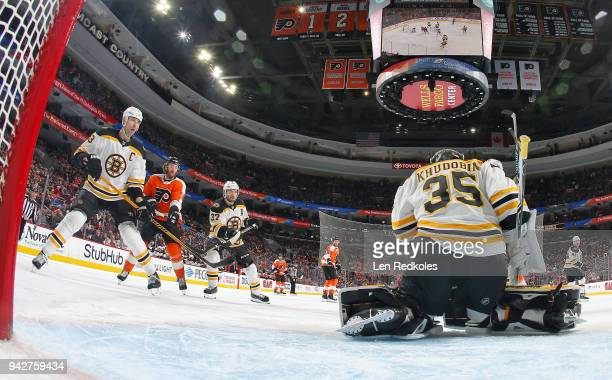 Anton Khudobin of the Boston Bruins stops a shot on goal with teammates Zdeno Chara and Patrice Bergeron against Sean Couturier of the Philadelphia...