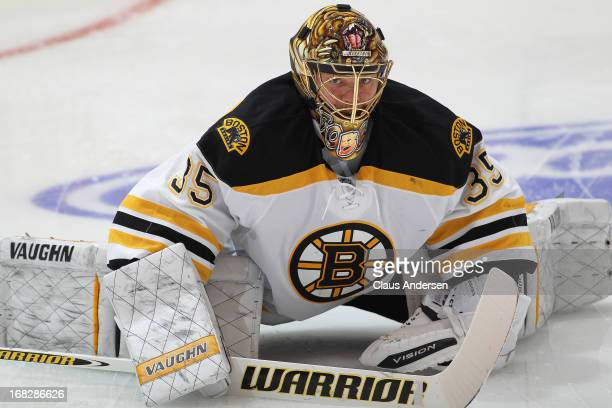 Anton Khudobin of the Boston Bruins stretches in the warmup prior to playing against the Toronto Maple Leafs in Game Three of the Eastern Conference...