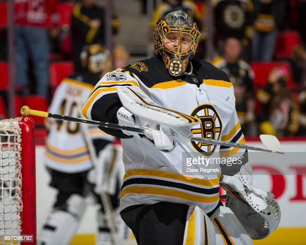 Anton Khudobin of the Boston Bruins takes some shots in warm ups before an NHL game against the Detroit Red Wings at Little Caesars Arena on December...