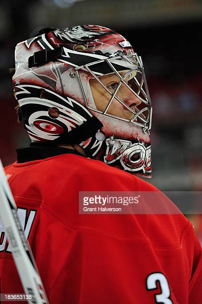 Anton Khudobin of the Carolina Hurricanes against the Detroit Red Wings during play at PNC Arena on October 4 2013 in Raleigh North Carolina The Red...
