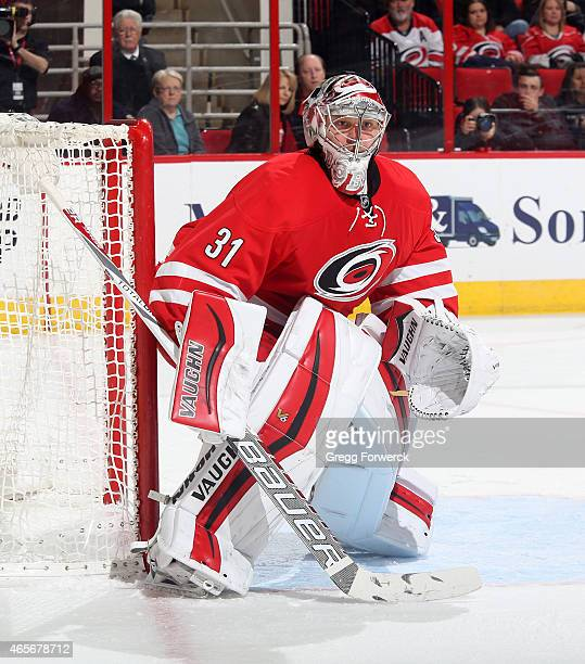 Anton Khudobin of the Carolina Hurricanes crouches in the cease to protect the net during their NHL game against the Minnesota Wild at PNC Arena on...