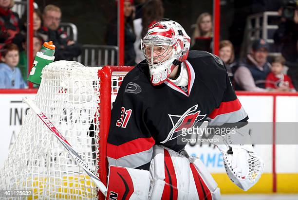 Anton Khudobin of the Carolina Hurricanes crouches in the crease and squeezes the left the pipe to protect the net during their NHL game against the...