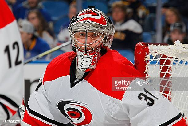 Anton Khudobin of the Carolina Hurricanes follows the puck in their game against the Buffalo Sabres on January 23 2014 at the First Niagara Center in...