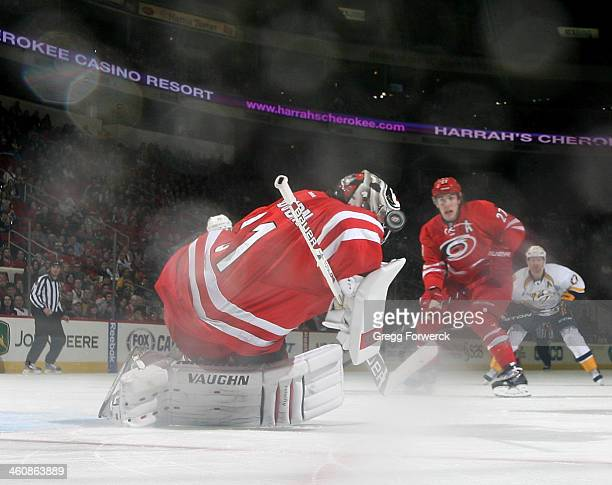 Anton Khudobin of the Carolina Hurricanes goes down in the crease to make a save during their NHL game against the Nashville Predators at PNC Arena...