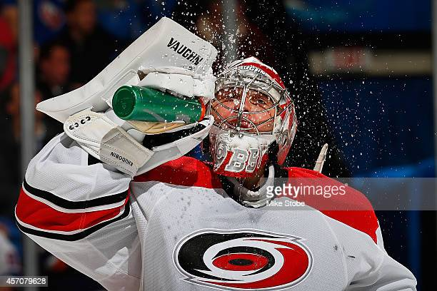 Anton Khudobin of the Carolina Hurricanes takes a break during a stoppage of play durring a game against the New York Islanders at Nassau Veterans...