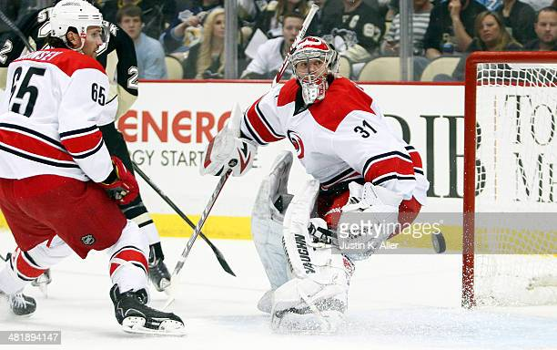 Anton Khudobin of the Carolina Hurricanes watches a puck through the crease against the Pittsburgh Penguins during the game at Consol Energy Center...