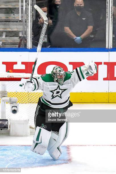 Anton Khudobin of the Dallas Stars celebrates the game-winning goal by teammate Joel Kiviranta , against the Colorado Avalanche during the first...