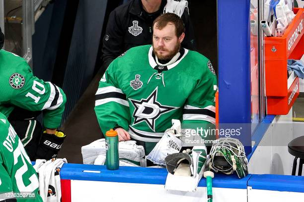Anton Khudobin of the Dallas Stars looks on from the bench against the Tampa Bay Lightning during the third period in Game Three of the 2020 NHL...