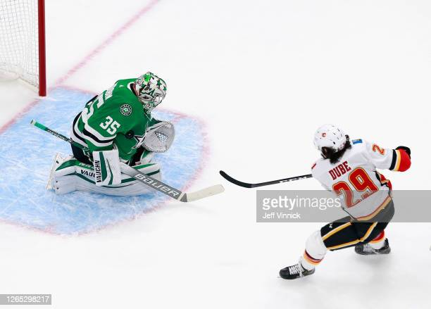 Anton Khudobin of the Dallas Stars makes the first period chest save on Dillon Dube of the Calgary Flames in Game One of the Western Conference First...