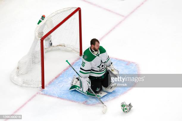 Anton Khudobin of the Dallas Stars reacts after allowing a goal to TJ Brodie of the Calgary Flames during the third period in Game Three of the...