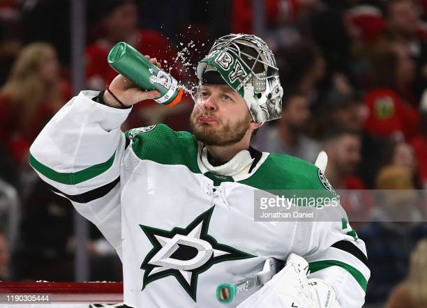 Anton Khudobin of the Dallas Stars spits out water during the third period against the Chicago Blackhawks at the United Center on November 26, 2019...