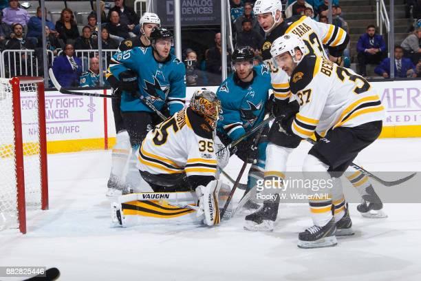 Anton Khudobin Zdeno Chara and Patrice Bergeron of the Boston Bruins defend the net against Jannik Hansen of the San Jose Sharks at SAP Center on...