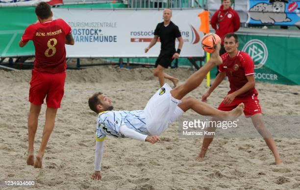 Anton Kniller, Julian Franz and Vitaly Vasilets challenge for the ball during the German Beachsoccer Championship 3rd place match between Bavaria...