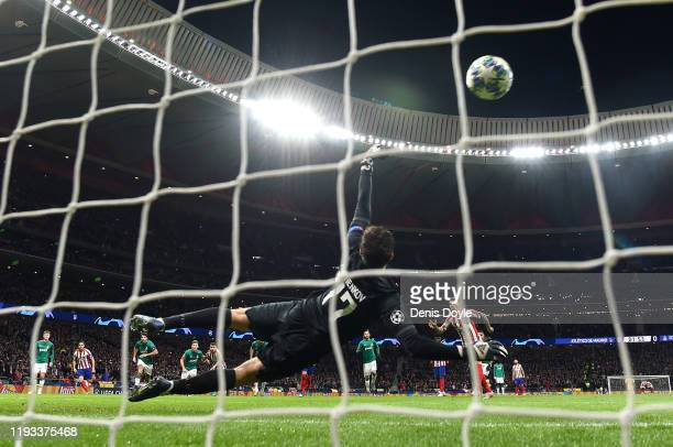 Anton Kochenkov of Lokomotiv Moscow saves the penalty taken by Kieran Trippier of Atletico Madrid during the UEFA Champions League group D match...