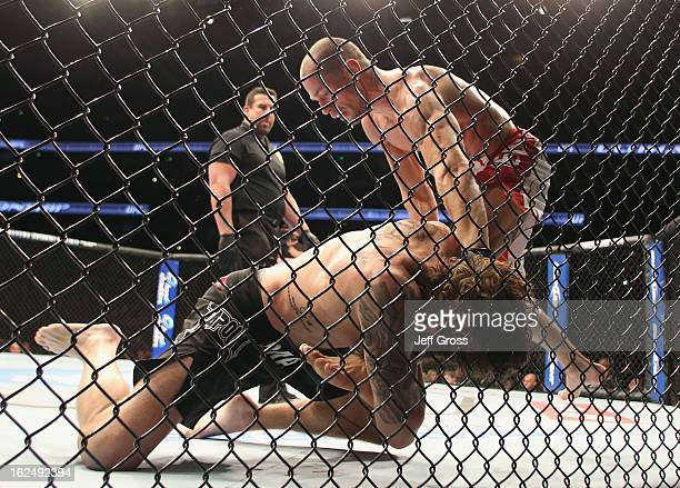 Anton Kuivanen of Finland and Michael Chiesa fight following their UFC Lightweight bout at Honda Center on February 23 2013 in Anaheim California