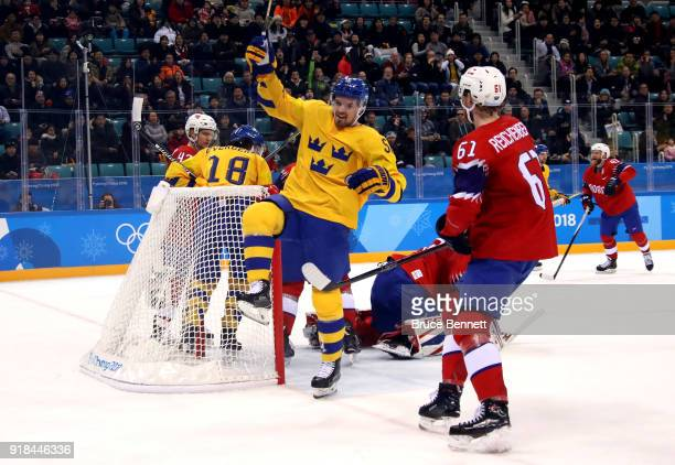 Anton Lander of Sweden celebrates after scoring his team's Sweden second goal past Lars Haugen of Norway during the Men's Ice Hockey Preliminary...