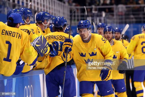 Anton Lander of Sweden celebrates with teammates after scoring in the first period against Finland during the Men's Ice Hockey Preliminary Round...