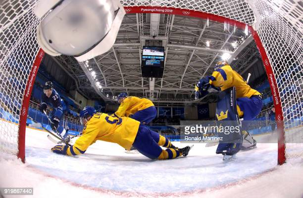 Anton Lander of Sweden dives to block a shot by Joonas Kemppainen of Finland in the second period during the Men's Ice Hockey Preliminary Round Group...