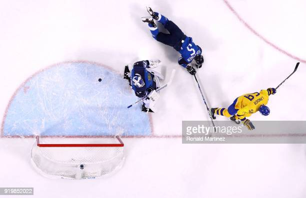 Anton Lander of Sweden reacts after scoring against Mikko Koskinen of Finland in the first period during the Men's Ice Hockey Preliminary Round Group...