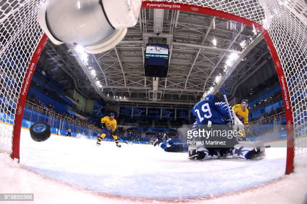 Anton Lander of Sweden shoots and scores against Mikko Koskinen of Finland in the first period during the Men's Ice Hockey Preliminary Round Group C...