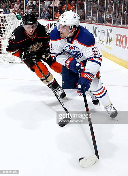 Anton Lander of the Edmonton Oilers handles the puck against Cam Fowler of the Anaheim Ducks on April 1 2015 at Honda Center in Anaheim California